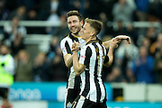 Newcastle United midfielder Matt Ritchie (#11) celebrates Newcastle United's second goal (2-0) with Newcastle United forward Daryl Murphy (#33) during the EFL Sky Bet Championship match between Newcastle United and Rotherham United at St. James's Park, Newcastle, England on 21 January 2017. Photo by Craig Doyle.