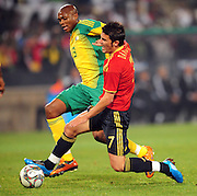 Kagisho Dikgacoi and David Villa  during the soccer match of the 2009 Confederations Cup between Spain and South Africa played at the Freestate Stadium,Bloemfontein,South Africa on 20 June 2009.  Photo: Gerhard Steenkamp/Superimage Media.