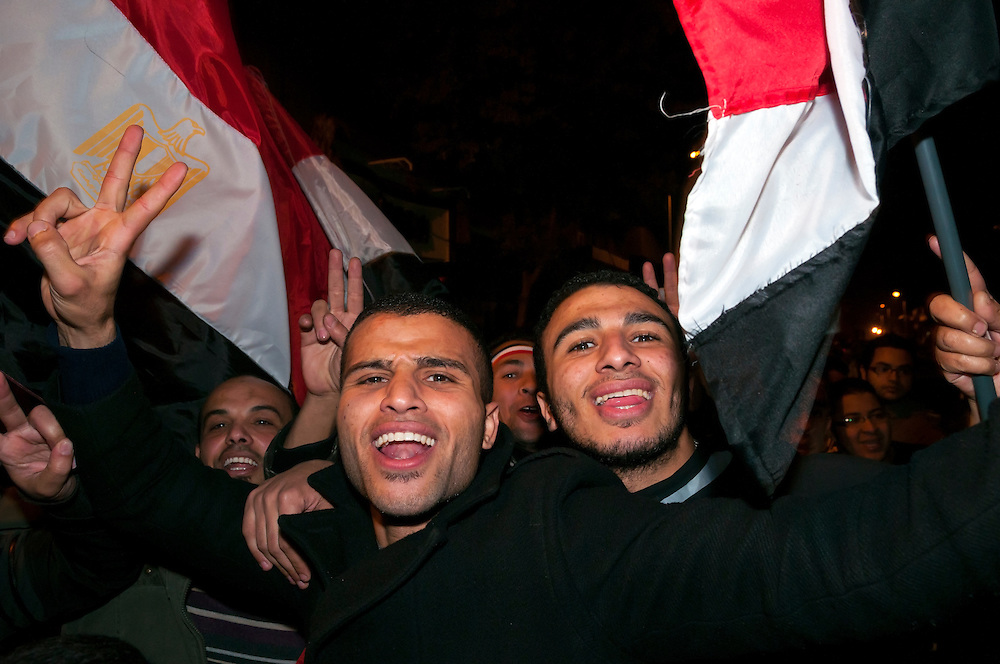 Men celebrate in Tahrir Square shortly after the announcement that Hosni Mubarak had resigned. (Cairo, Egypt - February 11, 2011)