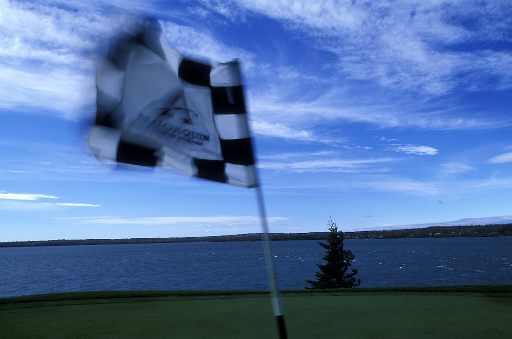 Canada, New Brunswick, Saint Andrews, Wind whips flag at signature 12th hole on Algonquin Hotel's golf course on fall day