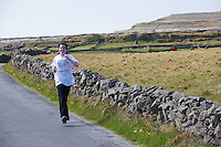 A weekend of glorious weather welcomed approximately 150 people from all over the country and abroad to Inis Mor , Arann Islands to participate in the annual Aer Arann half marathon.  Over the past ten years people have walked and ran the roads of Inis Mor to raise in excess of 1.2 million to purchase vital life saving equipment for sick children in both Crumlin and Temple Street hospitals.  Christina Quinn Glen Burren park in Galway ran the course . Photo:Andrew Downes.
