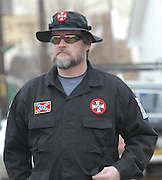 RAY LARSON INTERNATIONAL IMPERIAL WIZARD OF THE KKK, FROM SOUTH BEND INDIANA, passes out application for citzenship for the Churchof the National Knights Ku Klux Klan Inc. during a rally at the Jena court house on MLK day.CAME TO PROTEST WITH DAN QUINN GRAND DRAGON OF ALABAMA KKK.A group of protesters march to Jena High School on the Martin Luther King Jr. holiday in Jena, La., Monday, Jan. 21, 2008. The protest was organized by the self-described 'pro-majority' Nationalist Movement of Learned, Mississippi, lead by Richard Barrett, and was being held in opposition to the six black teenagers who were arrested in the beating of a white classmate in December 2006, and the King holiday. The protest drew about 50 participants and 100 counter-demonstrators to Jena.(Photo/© Suzi Altman)A group of protesters march to Jena High School on the Martin Luther King Jr. holiday in Jena, La., Monday, Jan. 21, 2008. The protest was organized by the self-described 'pro-majority' Nationalist Movement of Learned, Mississippi, lead by Richard Barrett, and was being held in opposition to the six black teenagers who were arrested in the beating of a white classmate in December 2006, and the King holiday. The protest drew about 50 participants and 100 counter-demonstrators to Jena.(Photo/© Suzi Altman)