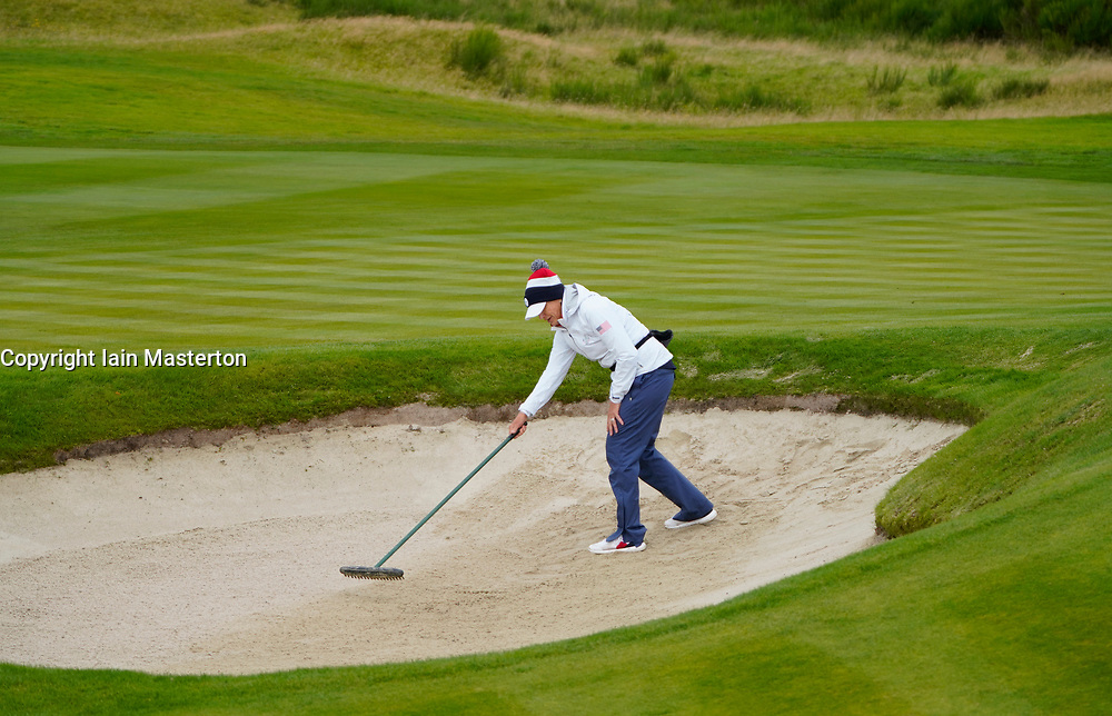 Auchterarder, Scotland, UK. 12 September 2019. Final practice day at 2019 Solheim Cup on Centenary Course at Gleneagles. Pictured; Juli Inkster, team Captain of USA rakes bunker. Iain Masterton/Alamy Live News