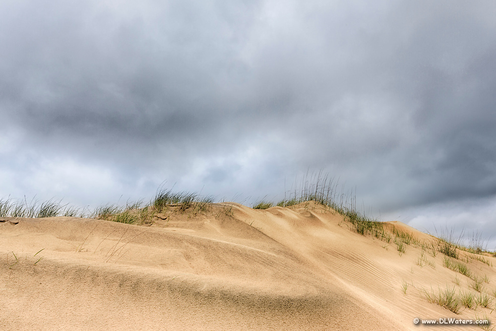 Photographing on the edge of weather often produces interesting results. Photo of Jockey's Ridge State Park on the Outer Banks in inclement weather.