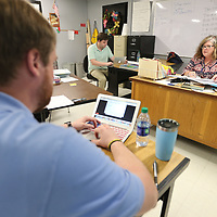 Tupelo Middle School teacher Eileen Bailey, right, begins working on seventh grade lesson plans for the next school with other teachers Tuesday morning.