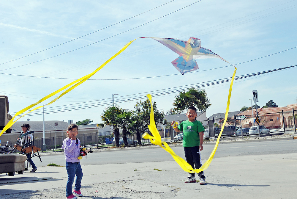 "Carlos Mejia, 6, and a friend fly his ""papalote,"" or flying kite, under the power lines near Jesse Sanchez Elementary School in east Salinas."