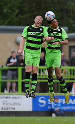 Forest Green Rovers's Charlie Clough and Forest Green Rovers's Kurtis Guthrie jump for the high ball.  - Photo mandatory by-line: Nizaam Jones - Mobile: 07966 386802 - 25/04/2015 - SPORT - Football - Nailsworth - The New Lawn - Forest Green Rovers v Dover - Vanarama Conference League