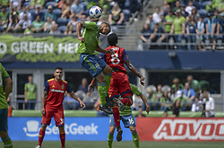 May 26, 2018 - Seattle, Washington, U.S - MLS Soccer 2018: Seattle midfielder JORDY DELEM (21) and RSL's DAMIR KREILACH (8) go up for a ball as Real Salt Lake visits the Seattle Sounders in a MLS match at Century Link Field in Seattle, WA. (Credit Image: © Jeff Halstead via ZUMA Wire)