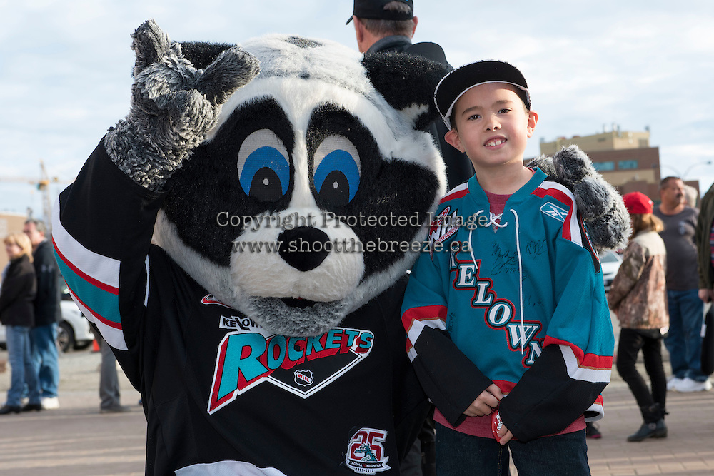 KELOWNA, CANADA - MARCH 25: Rocky Racoon, the mascot of the Kelowna Rockets poses with  young fan on March 25, 2016 at Prospera Place in Kelowna, British Columbia, Canada.  (Photo by Marissa Baecker/Shoot the Breeze)  *** Local Caption *** Rocky Racoon; Fan;