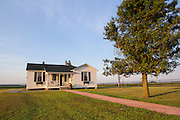 The boyhood home of musician Johnny Cash stands in a field on Saturday, August 16, 2014, in Dyess, Ark. The home was restored to it's appearance when the Cash family lived in it, from 1935-1954, and was part of The Dyess Colony that was created in 1934 as part of President Franklin D. Roosevelt's New Deal.<br /> <br /> Photo by Beth Hall