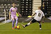 Reading FC defender Chris Gunter wins the ball ahead of Derby County forward Johnny Russell during the Sky Bet Championship match between Derby County and Reading at the iPro Stadium, Derby, England on 12 January 2016. Photo by Aaron Lupton.