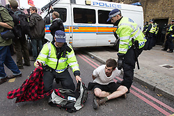 © Licensed to London News Pictures . 07/09/2013 . London , UK . A counter protester is detained by police after he tried to get to the EDL demonstration . The EDL hold a march and demonstration in London today (Saturday 7th September 2013) . Photo credit : Joel Goodman/LNP