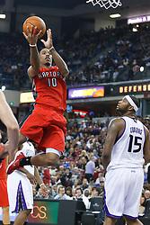 November 1, 2010; Sacramento, CA, USA;  Toronto Raptors shooting guard DeMar DeRozan (10) shoots past Sacramento Kings power forward DeMarcus Cousins (15) during the third quarter at the ARCO Arena. The Kings defeated the Raptors 111-108.