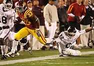 25 OCTOBER 2008: Iowa State running back Alexander Robinson (33) jumps over a tackle in the first half of an NCAA college football game between Iowa State and Texas A&M, at Jack Trice Stadium in Ames, Iowa on Saturday Oct. 25, 2008. Texas A&M beat Iowa State 49-35.