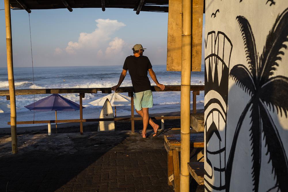 A man looks toward the horizon at Echo beach, Canggu.