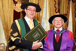 NUI honours President of Ireland, .His Excellency, Dr Michael D. Higgins...Wednesday, 25 January 2012  St. Patricks Hall, Dublin Castle..At a ceremony in Dublin Castle, the Chancellor of the National University of Ireland, Dr Maurice Manning conferred the honorary degree of Doctor of Laws (LLD) on the President of Ireland, His Excellency, Dr Michael D. Higgins. ..Pictured (L-R) Vice-Chancellor of NUI and President of NUI Galway, Dr Jim Browne; President of Ireland, His Excellency, Dr Michael D. Higgins..In his introductory citation, Dr Jim  Browne, Vice-Chancellor of NUI and President of NUI Galway defined the conferring as honouring an extraordinary man who personifies and combines so many decencies that, taken individually, we perceive to be ordinary..In a phrase used by the late President Cearbhall O Dalaigh to characterise the role of President, Dr Browne said that  As the ninth President of Ireland Michael D. Higgins is, somewhat paradoxically, the primus inter pares or first among equals. .Referring to the Presidents election, Dr Browne said that his radical egalitarianism animated his claim to be elected as Uachtaran na hEireann in 2011. It posited a moral choice not between the state and the market but between two versions of the state. We were invited to reconceive the role of government in a re-imagined state and to engage without shame in an ethically informed public conversation about the choices that this would entail..It was an unapologetic claim that placed ethics before competence in what he prescribed as a real Republic. It challenged the Irish people to accept that adjustment by daring to re-imagine and revive almost-forgotten decencies. Over one million voters rose to that challenge..Dr Browne summarised the Presidents political career in the following terms:  First elected to Dail Eireann in 1981, he represented Galway-West as a T.D. until 2011. Michael D. Higgins has identified, amplified and championed the rights and intere