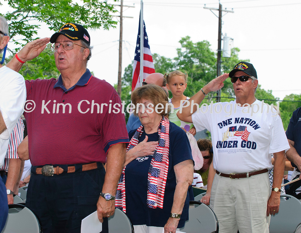 Veterians salute during the National Anthem during the dedication of the new Friendswood Veterans Memorial that was dedicated today.