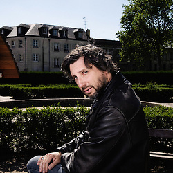 "French director Bruno Podalydes at the square des Francines where he shot his last movie ""Les bancs publics"". Versailles, France. May 29, 2009. Photo: Antoine Doyen"