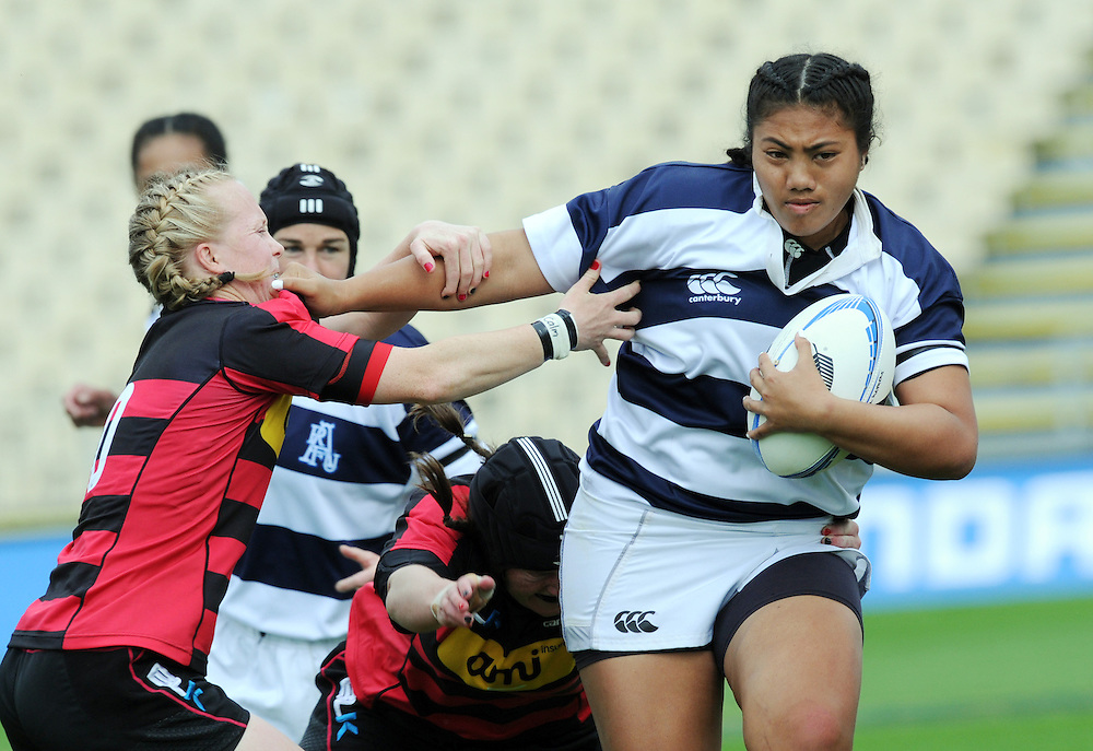 Auckland's Onjeurlina Leiataua fends off Canterbury's Kendra Cocksedge in the ITM Cup Women's final rugby match, AMI Stadium, Christchurch, New Zealand, Saturday, October 27, 2012. Credit:SNPA / Ross Setford