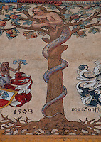 Detail of frieze on a building facade in Lucerne, Switzerland featuring Eve as a temptress snake.