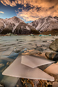 Ice floes in partly frozen Tasman Glacier lake, winter dawn, Mount Cook National Park