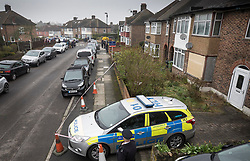 © Licensed to London News Pictures. 11/04/2018. London, UK. Police are still guarding the house of Richard Osborn-Brooks (R) in sight of floral tributes placed nearby (top left) to  Henry Vincent who was killed as he burgled the home of 78 year old Richard Osborn-Brooks. Mr Osborn-Brooks was arrested for murder but later released without charge. Friends and family of Henry Vincent have had floral tributes they placed near the scene repeatedly torn down by locals. Photo credit: Peter Macdiarmid/LNP