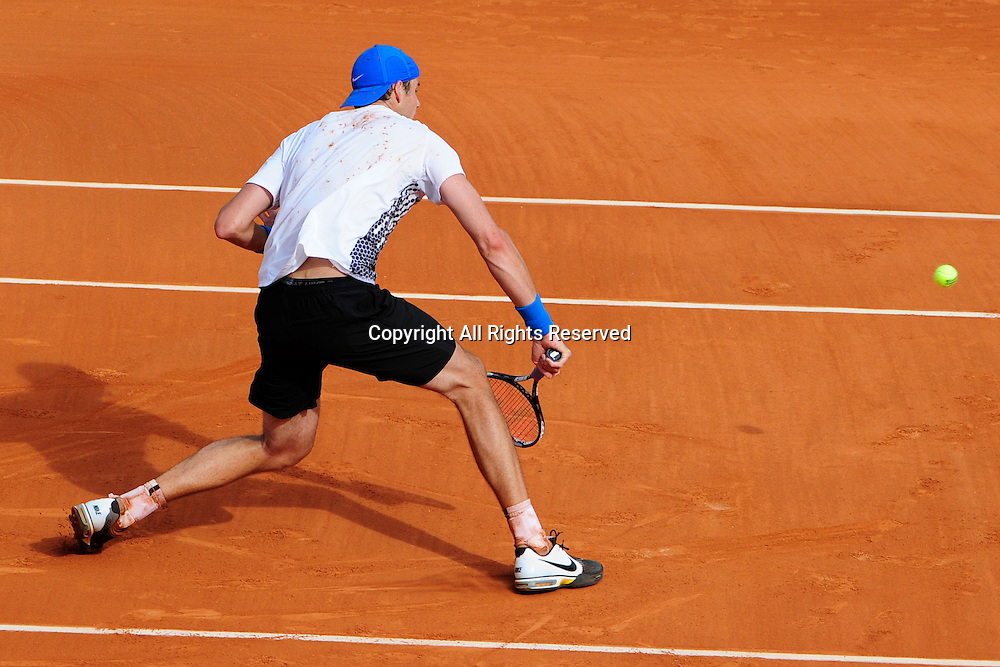 24.05.2011 French Open Tennis from Roland Garros Paris. John Isner of the USA returns a shot in his match against Rafael Nadal of Spain on day three of the French Open tennis championships.
