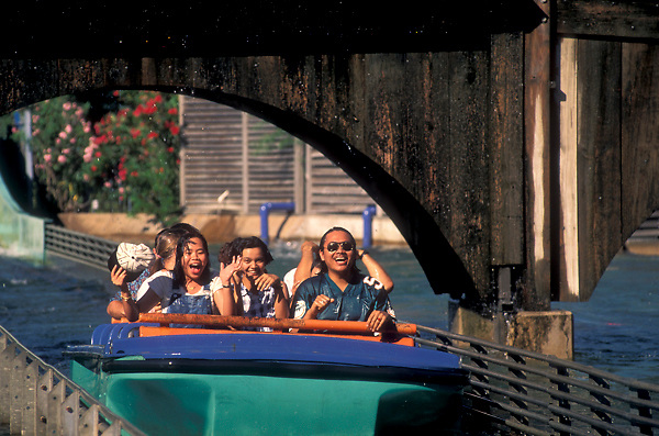 Stock photo of a group of wet, happy riders on the log ride at Astroworld in Houston Texas