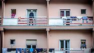 Potenza, Basilicata, Italia, 20/10/2014<br /> L'Hotel Tourist in localit&agrave; Rifreddo di Pignola, alle porte di Potenza, dove alloggiano numerosi rifugiati africani. Tra di loro i componenti della squadra di calcio Opt&igrave; Pob&agrave;. La squadra che porta il nome del fantomatico giocatore della Lazio inventato dal presidente della Figc Carlo Tavecchio partecipa a un campionato amatoriale di calcio a 11. L&rsquo;idea &egrave; venuta a Francesco Giuzio, ventisettenne potentino con una laurea in relazioni internazionali e un passato da analista video di partite di calcio.<br /> <br /> Potenza, Basilicata, Italy, 20/10/2014<br /> Hotel Tourist in Rifreddo of Pignola, near Potenza, where several African refugees are hosted. Among them there are the players of Opt&igrave; Pob&agrave;. The team has been formed in the wake of a racism scandal in which the new Italian football league president referred to black players whose only previous qualification was eating bananas. Opti Poba has joined an amateur championship in southern Italy. The team was born thanks to Francesco Giuzio, 27, who is also the coach.
