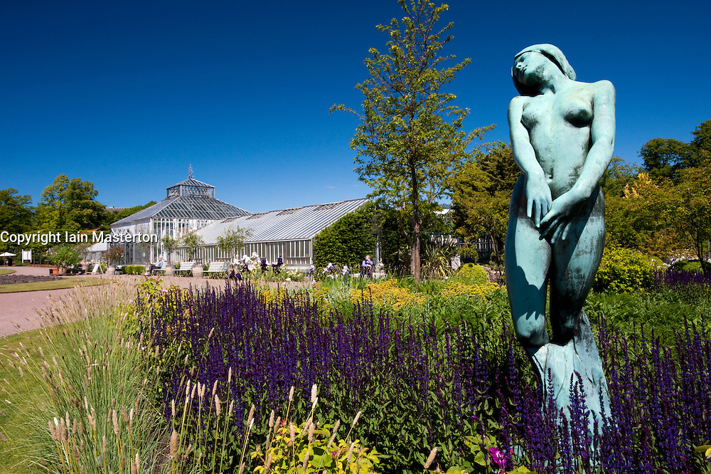 Statue and glasshouse in Tradgardsforeningen Park in Gothenburg Sweden