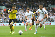Burton Albion's Joe Mason takes on Leeds United defender Liam Cooper during the EFL Sky Bet Championship match between Leeds United and Burton Albion at Elland Road, Leeds, England on 9 September 2017. Photo by John Potts.