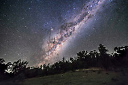 The southern Milky Way and galactic centre rising on an April night in Australia, with the constellations of Sagittarius and Scorpius coming up, and the bulge of the galactic centre above the treetops. The sky is discoloured by some bands of airglow. Alpha and Beta Centauri are at top right. Antares is left of centre. The dark lanes here form the neck and body of the Dark Emu. <br /> <br /> This is a stack of 8 x 45-second exposures for the ground, mean combined to smooth noise, and one 45-second untracked exposure for the sky, all with the Rokinon 14m lens at f/2.5 and Canon 6D at ISO 3200. Taken as part of a 500-frame time-lapse sequence.
