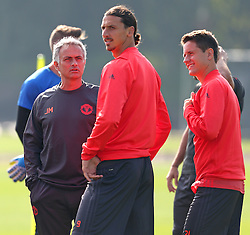 Manchester United manager Jose Mourinho talks with Zlatan Ibrahimovic - Mandatory by-line: Matt McNulty/JMP - 14/09/2016 - FOOTBALL - Manchester United - Training session ahead of Europa League Group A match against Feyenoord