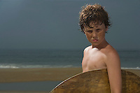 Portrait of boy with surfboard