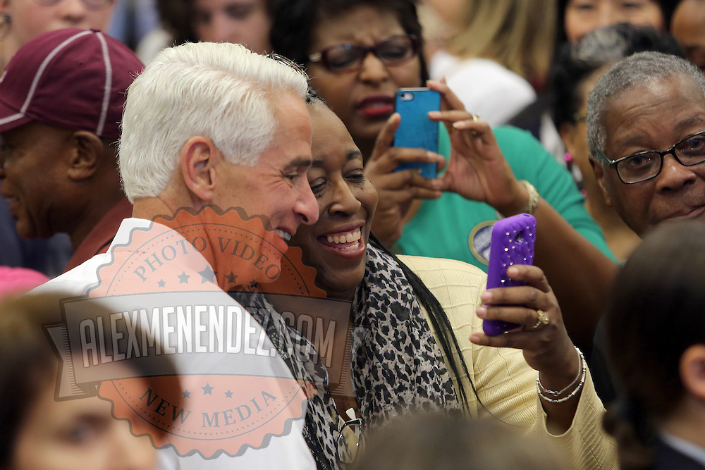 """Charlie Crist shakes hands with supporters after First Lady Michelle Obama appeared at his grassroots """"Commit to Vote"""" rally. The campaign called on the event to """" energize voters and lay out the stakes for Floridians in the critical election on November 4th."""" at the Barnett Park Gymnasium in Orlando, Florida on Friday, Nov. 17, 2014. (AP Photo/Alex Menendez)"""
