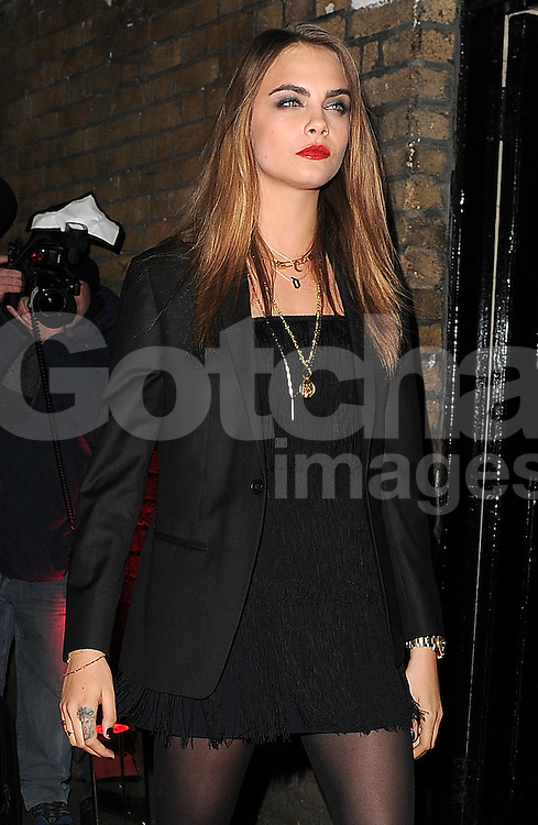 Model Cara Delevingne attends the YSL Beauty: YSL Loves Your Lips party at The Boiler House,The Old Truman Brewer in London, UK. 20/01/2015<br />