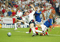 England v France - Estadio de Luz, Lisbon - 13th June 2004<br />England's Wayne Rooney is fouled in the area by France's Mikael Sylvestre giving away a penalty<br />Photo: Jed Leicester/Sporting Pictures<br />© Sporting Pictures (UK) Ltd<br />www.sportingpictures.com<br />Tel: +44 (0)20 7405 4500<br />Fax: +44 (0)20 7831 7991