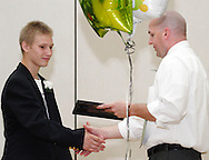 Scott Riley (left) receives a certificate of completion from Principal Aaron Smith during the 8th grade recognition ceremony at Cleveland PK-8 School in Dayton, May 25, 2012.