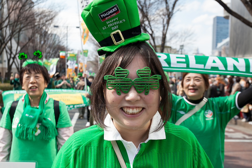 """People dressed in green enjoy the 27th Saint .Patrick's Day Parade in Omotesando, Tokyo, Japan. Sunday March 17th 2019. Started in 1992 by the Irish Network, Japan, and supported by the Embassy of Ireland,; the parade, along with the """"I Love Ireland Festival"""" held nearby is Asia's  largest Irish event."""