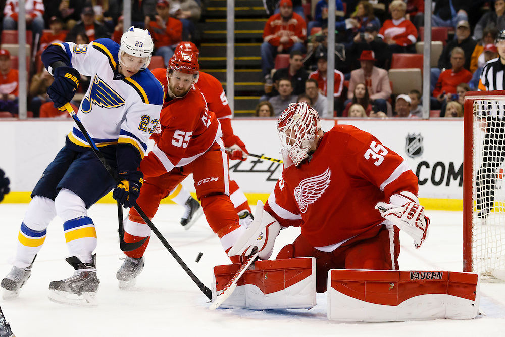 Mar 22, 2015; Detroit, MI, USA; Detroit Red Wings goalie Jimmy Howard (35) makes a save on St. Louis Blues right wing Dmitrij Jaskin (23) in the second period at Joe Louis Arena. Mandatory Credit: Rick Osentoski-USA TODAY Sports