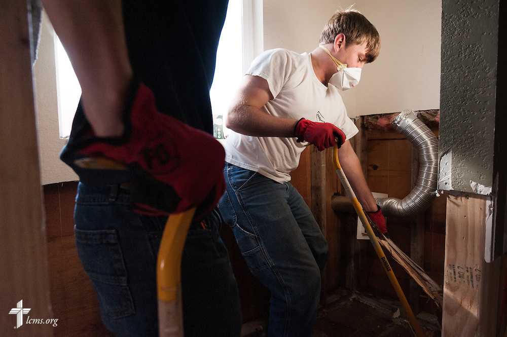Travis Buttke (right), a senior student with Mt. Calvary Lutheran Student Fellowship at South Dakota State University, helps gut the interior of a home damaged by the September flooding on Wednesday, Jan. 8, 2014, in Lyons, Colo. Buttke is one of seven students and one vicar who traveled to the ravaged area for volunteer relief work. LCMS Communications/Erik M. Lunsford