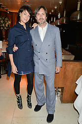 CHARLOTTE STOCKDALE and MARC NEWSON at a dinner to celebrate the publication of Obsessive Creative by Collette Dinnigan hosted by Charlotte Stockdale and Marc Newson held at Mr Chow, Knightsbridge, London on 9th February 2015.
