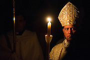 DENVER, CO - APRIL 19: Archbishop Samuel J. Aquila looks on with a candle at the start of the Easter Vigil Mass at the Cathedral Basilica of the Immaculate Conception on April 19, 2014, in Denver, Colorado. (Photo by Daniel Petty/Denver Catholic Register)