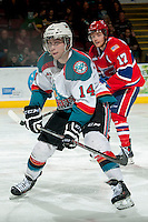 KELOWNA, CANADA - MARCH 5:  Rourke Chartier #14 of the Kelowna Rockets skates against the Spokane Chiefs on March 5, 2014 at Prospera Place in Kelowna, British Columbia, Canada.   (Photo by Marissa Baecker/Getty Images)  *** Local Caption *** Rourke Chartier;