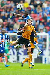 WIGAN, ENGLAND - Monday, May 3, 2010: Wigan Athletic's Mohamed Diame and Hull City's Will Akinson during the Premiership match at DW Stadium. (Photo by David Rawcliffe/Propaganda)