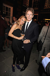 PATRICK KIELTY and OLIVIA CRISTAU at a party to celebrate the opening of the new home of Alfred Dunhill at Bourdon House, 2 Davies Street, London on 16th September 2008.