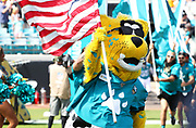 Oct 13, 2019; Jacksonville, FL USA;  Jaxson de Ville, the Jacksonville Jaguars mascot leads the team out of he tunnel before an NFL game against the New Orleans Saints at TIAA Bank Field in Jacksonville, FL. The Saints beat the Jaguars 13-6. (Steve Jacobson/Image of Sport)