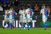 Blackburn Rovers celebrate as Derrick Williams of Blackburn Rovers scores a goal 0-1 during the EFL Sky Bet Championship match between Hull City and Blackburn Rovers at the KCOM Stadium, Kingston upon Hull, England on 20 August 2019.