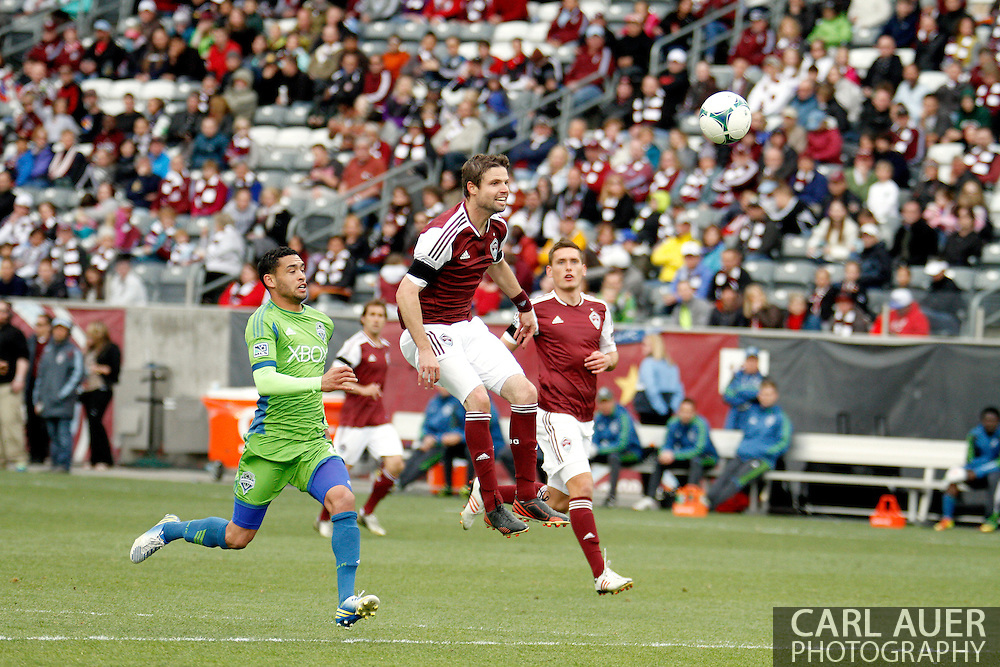 April 20th, 2013 Commerce City, CO - Colorado Rapids defender Drew Moor (3) watches the ball after he heads it back to his goalkeeper away from the offense from Seattle Sounders FC midfielder Lamar Neagle (27) in the second half of action of the MLS match between the Seattle Sounders FC and the Colorado Rapids at Dick's Sporting Goods Park in Commerce City, CO