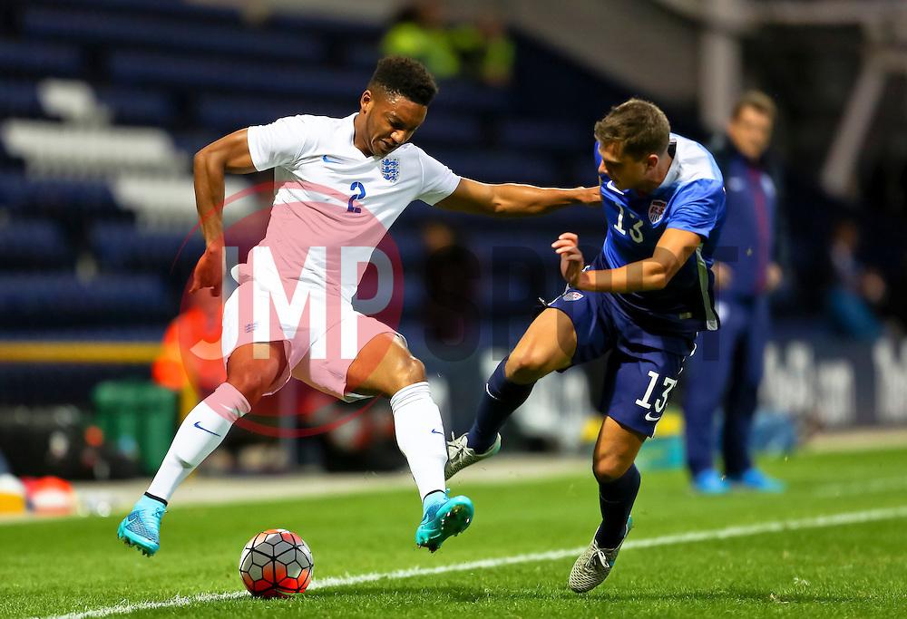 Joe Gomez of England U21 with Marc Pelosi of USA U23  - Mandatory byline: Matt McNulty/JMP - 07966386802 - 03/09/2015 - FOOTBALL - Deepdale Stadium -Preston,England - England U21 v USA U23 - U21 International